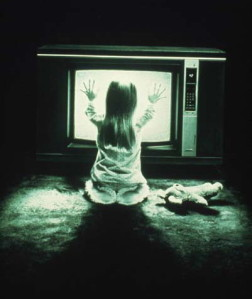 Little girl in front of a TV during the night